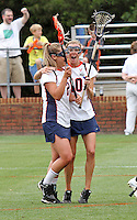 The University of Virginia women's lacrosse players Kelly Austin, left, and Kaitlin Duff, right, celebrate the 14-12 victory over Towson during the first game since the tragic death of Virginia player Yeardley Love Sunday May 16, 2010 at Klockner Stadium in Charlottesville, Va. The Cavaliers rallied in the last four minutes to beat Towson and reach the quarter finals of the NCAA tournament. Love's body was found May 3, and Virginia men's lacrosse player George Huguely is charged with murder. Photo/Andrew Shurtleff...