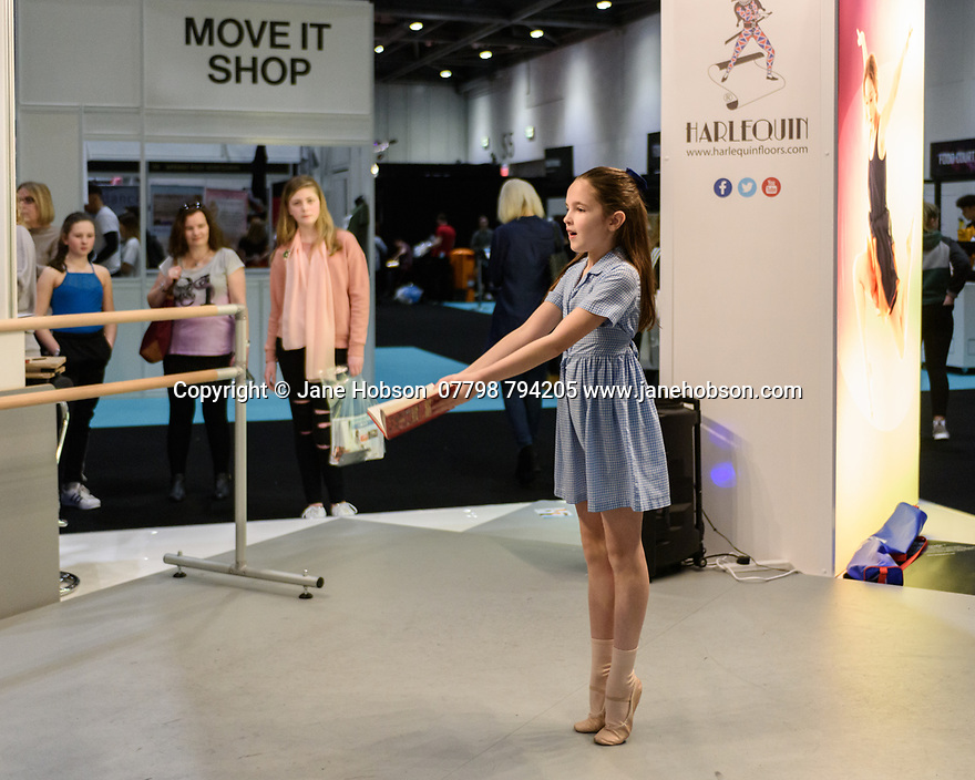 A girl dances on the Harlequin flooring stand, at Move It, the dance trade show, at ExCel, London.