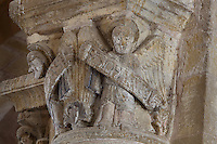 Carved capital with angels holding phylacteries, from the galleries of the Abbatiale Sainte-Foy de Conques or Abbey-church of Saint-Foy, Conques, Aveyron, Midi-Pyrenees, France, a Romanesque abbey church begun 1050 under abbot Odolric to house the remains of St Foy, a 4th century female martyr. The church is on the pilgrimage route to Santiago da Compostela, and is listed as a historic monument and a UNESCO World Heritage Site. Picture by Manuel Cohen