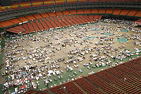 Hurricane Katrina evacuees from New Orleans find shelter in Houston's Astrodome in 2005.