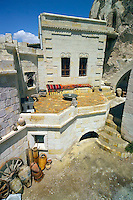 Goreme, Cappadocia, Turkey, July 2005. The courtyard is covered with natural stone and mounted in the wall is an Ottoman fireplace. Dutch Photographer Frits Meyst and his wife Jillian Macdonald restored an old rock house in the village of Goreme. Since Roman Times people have been cutting graves and home out of the Soft tufo 'Fairy Chmney' rocks of Cappadocia. Photo by Frits Meyst / MeystPhoto.com