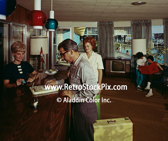 Bonanza Motel, Wildwood, NJ. Couple checking in at the Lobby front desk.