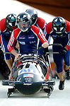 20 November 2005: Mike Kohn leads the USA 2 sled pushoff in the first run of the 2005 FIBT AIT World Cup Men's 4-Man Bobsleigh Tour, piloting the team to a 7th place finish at the Verizon Sports Complex, in Lake Placid, NY. Mandatory Photo Credit: Ed Wolfstein.