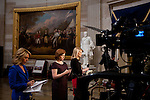 Television reporters wait to do live spots in the US Capitol Rotunda during the presidential inauguration, January 21, 2013.