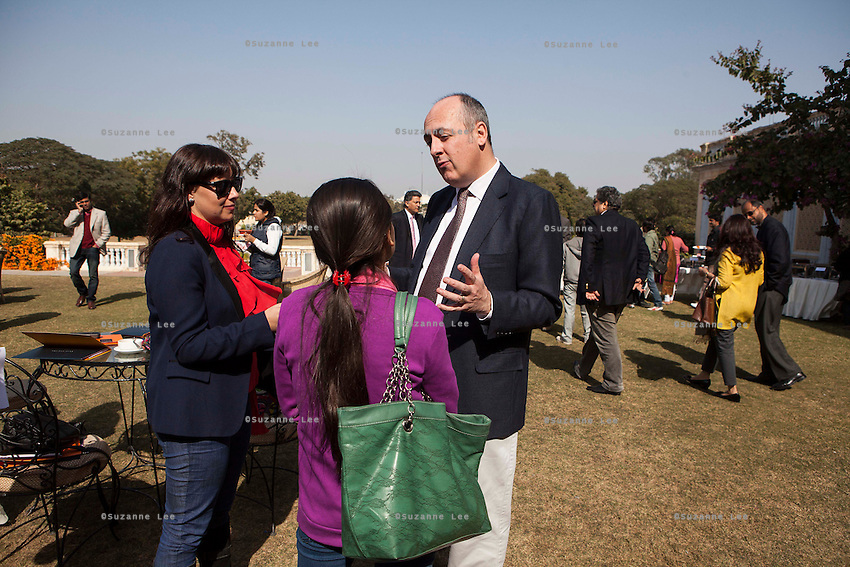 Dr. Lachlan Strahan (Australian High Commissioner to India) (right) gives an interview to a print journalist (center) as Kathryn Deyell (DFAT) (left) records the interview during lunch after a press conference on Oz Fest in Raj Mahal Palace hotel, Jaipur, India on 10th January 2013. Photo by Suzanne Lee/DFAT