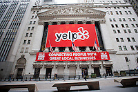 The facade of the New York Stock Exchange in Lower Manhattan in New York is seen on Friday, March 2, 2012 decorated in honor of the initial public offering of Yelp, the online crowdsourcing review site. The eight year old, still unprofitable company priced its IPO at $15 per share. Beside restaurants, Yelp carries reviews by viewers of a multitude of businesses and services. (© Richard B. Levine)