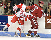 Sahir Gill (BU - 28), Danny Biega (Harvard - 9) - The Boston University Terriers defeated the visiting Harvard University Crimson 5-2 on Saturday, January 15, 2011, at Agganis Arena in Boston, Massachusetts.