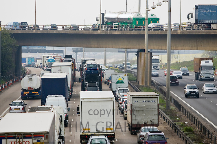 Congested traffic travelling on M1 motorway in Hertfordshire, United Kingdom