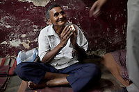 Bhaia Lal Tiwari, aged 68, sleeps at the Aashray Adhikar Abhiyan (AAA) Activity Center for homeless people on 4th October 2010, in Old Delhi, India. Bhaia Tiwari, from Madhya Pradesh, works in an electrical shop in Lajpat Nagar, Delhi, and visits his family twice a year. Picture: Suzanne Lee for The Australian.