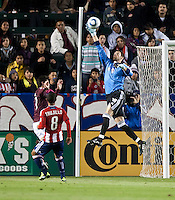 Colorado Rapids goalie Matt Pickens (18) goes up high to block a shot on goal during the first half of the game between Chivas USA and Colorado Rapids at the Home Depot Center in Carson, CA, on March 26, 2011. Final score Chivas USA 0, Colorado Rapids 1.