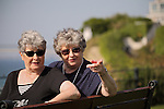 Twin elderly sisters pointing in a park - EXCLUSIVELY AVAILABLE HERE