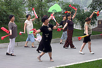 Chinese women practice Tai Chi in a city park along the Jin River - Chengdu, China in Sichuan Province