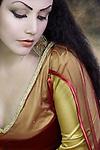 Beautiful Young Woman with long black hair wearing long dress looking down