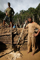 Miners rest while digging for gold at an open-air gold mine about 80km from Apui in the Brazilian state of Amazonas, Feb. 2, 2007. Thousands of people have created a virtually instant town in the remote Amazon forest to dig for gold in the region, discovered in Dec. 2006. The environment is not much of a concern as trees are felled and pits are dug by people from all over Brazil and from all walks of life. Most simply say that some deforestation in the immense amazon it is the price to pay for Brazilians to exploit their nation's riches. (FOTO:DOUGLAS ENGLE/AUSTRAL FOTO)