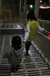 children in a station of Naha Monorail, Okinawa, Japan / Endants sur l'escalier mecanique d une station du monorail de Naha, Okinawa, Japon