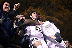 24 November 2013: Wake Forest's Ricky Greensfelder (25) celebrates his game winning goal with Tolani Ibikunle (right) and fans behind the wall on Walt Czyzowicz hill. The Wake Forest University Demon Deacons played the Naval Academy Midshipmen at Spry Stadium in Winston-Salem, NC in a 2013 NCAA Division I Men's Soccer Tournament Second Round match. Wake Forest won the game 2-1.