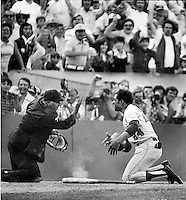 Umpire Augie Donatelli with Willie Mays at home plate during the 1973 New York Met vs. Oakland Athletics World Series game. Mays was arguing the out call of teamate at home. (photo by Ron Riesterer)
