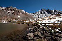 The tranquil surface of Deluge Lake contrast with the serrated peaks of the Gore Range in the Eagles Nest Wilderness area, Colorado.