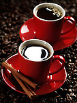 Two red cups of coffee on coffe beans background