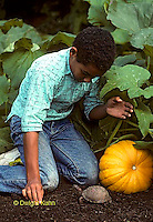 1R14-001z Minority Child with Box Turtle in Garden.