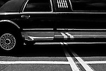 Limousine in parking lot close-up of side of limo with reflections