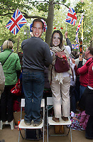 Tourist with Royal face masks look for Kate and Prince William in as the Royal party come down the mall in London. .Picture: Maurice McDonald/Universal News And Sport (Europe).29 April 2011...