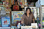 In Abucay, a seaside town in the Philippines province of Bataan, Gina Cunanan owns a small store along the main street. The woman had childhood polio. She is a member of the local Persons with Disabilities (PWD) organization. In the back is her mother, Marina Garcia