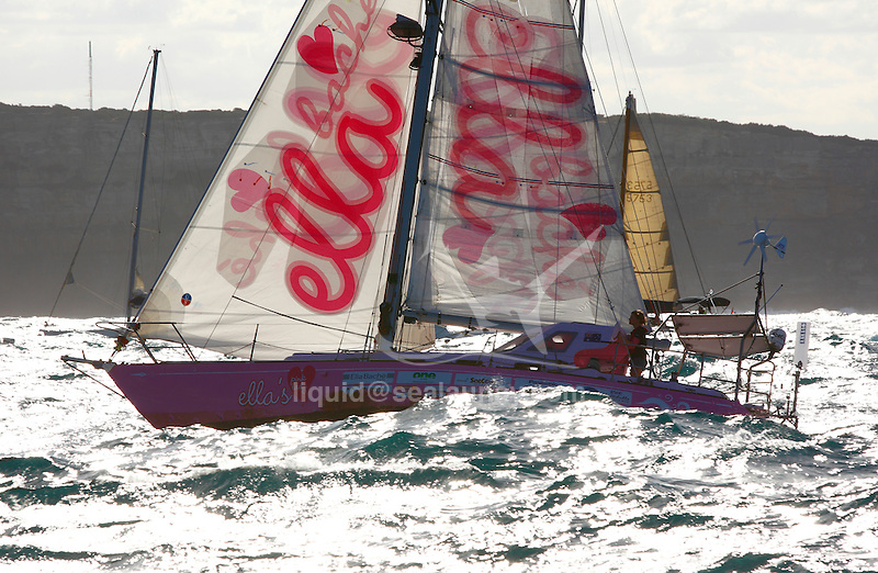 Jessica Watson, 16, crosses the finish line of her unassisted solo voyage around the world in her yacht Ella's Pink Lady S&amp;S (Sparkman and Stephens) 34 at Sydney Harbour.