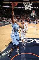 CHARLOTTESVILLE, VA- JANUARY 5: Chay Shegog #20 of the North Carolina Tar Heels shoots in front of Ataira Franklin #23 of the Virginia Cavaliers during the game on January 5, 2012 at the John Paul Jones arena in Charlottesville, Virginia. North Carolina defeated Virginia 78-73. (Photo by Andrew Shurtleff/Getty Images) *** Local Caption *** Ataira Franklin;Chay Shegog