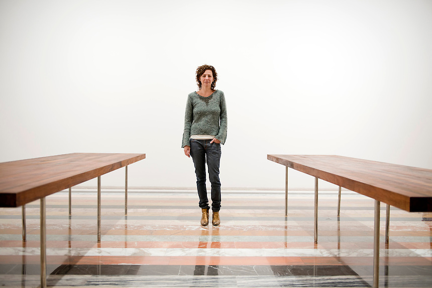 Curator Magali Arriola standing on a marble floor by artist Martin Creed. The new Jumex Museum.  Mexico City