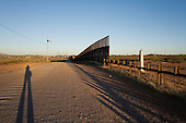 Naco, Arizona.USA.October 21, 2006..The border fence with Mexico, to deter immigrates from entering the country illegally at this port of entry, ends just a few feet from the border crossing....