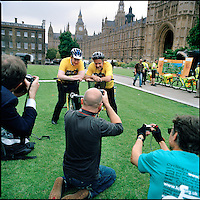 UK. London. From a story on Abingdon Street Gardens, a small patch of land, often referred to as College Green, that lies next to The Houses of Parliament in Westminster. It is a place where the media and the politicians come face to face. Interviews are held, photo shoots are set up and bewildered tourists stroll by..Photo shows a Labour MP Richard Caborn leads other MPs in a show of support for the London Grand Depart of the Tour de France, June 2007..Photo©Steve Forrest/Workers Photos