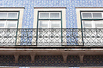 Windows and blue and white tiles of a building in Coimbra, Portugal. Azulejos in Coimbra, Portugal.