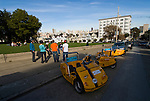 California: San Francisco. Tourists with electric cars at Alamo Square with view of Victorians and modern downtown. Photo copyright Lee Foster. Photo #: san-francisco-alamo-square-20-casanf77610