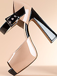 Closeup of a trendy thick high heel platform shoe isolated on beige background