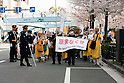 Tokyo, Japan - A photo made available on April 11 shows protestors marching on during a rally in downtown Tokyo in aims to shut down the Hamaoka Nuclear Power Plant, in Nagoya, Japan, 10 April 2011. Thousands of protestors demanded the immediate closure of the plant due to the nuclear crisis Japan is struggling with of the quake-hit Daiichi Nuclear Power Plant in Fukushima. The Hamaoka plant is built on top of the junction of tectonic plates in the Tokai area which is considered to be the area of concern for a major earthquake in the unforeseeable future. (Photo by Christopher Jue/AFLO) [2331]