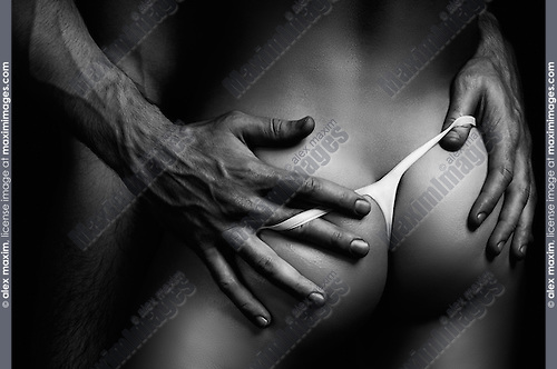 Sexy half nude young couple closeup of man hands on woman buttocks Black and white