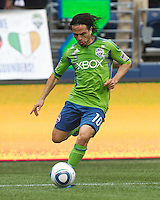 Seattle Sounders FC forward Mauro Rosales passes the ball during play against the New York Red Bulls at Qwest Field in Seattle Saturday June 23, 2011. The Sounders won the game 4-2.