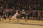 Lafayette High's Wesley Martin (32) makes a sack vs. Amory quarterback Forrest Wiliams (14) in the MHSAA 4A North Half playoffs in Amory, Miss. on Friday, November 25, 2011. Lafayette High won 35-7 to advance to the championship game, where it will face Laurel. Lafayette High is now 15-0 on the season and has won 31 games in a row.