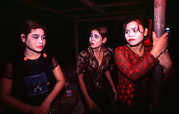 Phnom Penh, Cambodia. Teenaged prostitutes in brothel in Tuol Kork district. The girls here make US$30 a month, working on average 6 clients a day. Here the girls wait outside the brothel  for clients.<br />