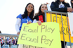 "10 April 2016: Two U.S. fans hold up a sign reading ""Equal Play Equal Pay"" in reference to the recent court action between the players' union and the U.S. Soccer Federation. The United States Women's National Team played the Colombia Women's National Team at Talen Energy Stadium in Chester, Pennsylvania in an women's international friendly soccer game. The U.S. won the match 3-0."
