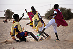 Boys play soccer in Timbuktu, the northern Mali city captured by Islamist forces in 2012 and liberated by French and Malian soldiers in 2013.