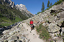 WY00610-00...WYOMING - Hiker in Cascade Canyon of Teton National Park.