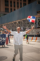 Independent Party Mayoral candidate Adolfo Carrion joins thousands of Dominican-Americans and their friends and supporters as he campaigns in the Dominican Day Parade in New York on Sixth Avenue on Sunday, August 11, 2013.  Politicians, flags and cultural pride were on display at the annual event. The primary election is approximately one month away. (© Richard B. Levine)