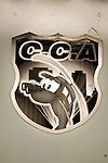 Logo at C.C.A.'s front door. C.C.A. is a company working alongside insurance companies. When cars that have a signal-emitting device are stolen, the company monitors the signal and search from the air using helicopters..photo: Eduardo Martino / 28.01.2008