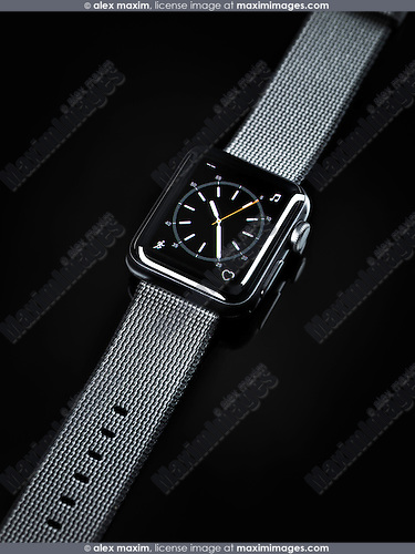 Apple Watch smartwatch with analogue clock dial on display isolated on black background