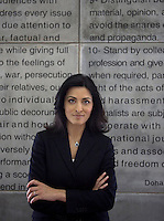News reader Ghida Fakhry photographed in front of the code of ethics at news channel Al Jazeera in Doha.