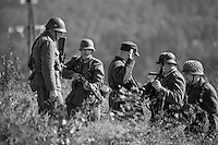 Reenactor playing the part of attacking German troops  and surrendering Norwegian soldiers in1940. <br /> <br /> Airplanes and reenactors photographed at in connection with H&oslash;ytorptreffet, an annual event at the H&oslash;ytorp fort. <br /> <br /> H&oslash;ytorp fort is a barrage fort in the Glomma defence line, built 1912-17. On April 13th and 14th 1940 the fort was in combat against German army units . It is now protected as a national monument.<br /> <br /> &copy;Fredrik Naumann/Felix Features