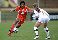 COLLEGE PARK, MD - OCTOBER 28, 2012:  Alex Reed (7) of the University of Maryland defends againt Blake Stockton (29) of Miami during an ACC  women's tournament 1st. round match at Ludwig Field in College Park, MD. on October 28. Maryland won 2-1 on a golden goal in extra time.