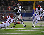 Ole Miss fullback E.J. Epperson (33) is chased by Louisiana-Lafayette's Orkeys Auriene (2)  vs. Louisiana-Lafayette in Oxford, Miss. on Saturday, November 6, 2010. Ole Miss won 43-21.